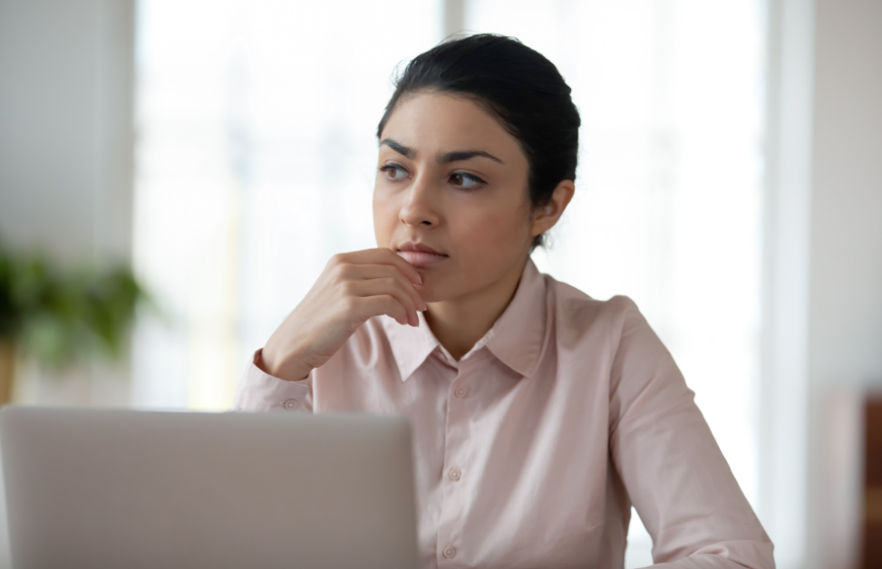 Thoughtful businesswoman considering her options for cloud consolidation